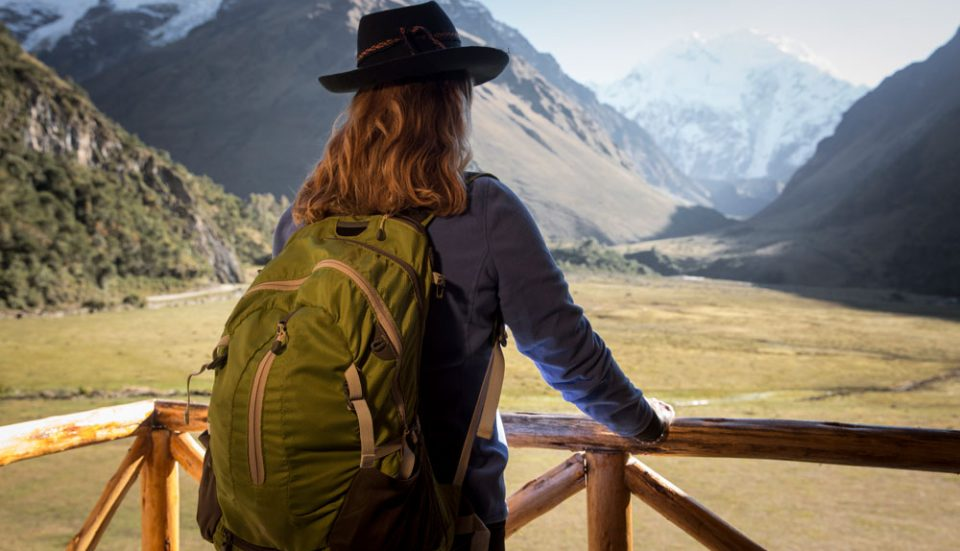 Surveying the upcoming journey to Salkantay Pass from your private balcony at Salkantay Lodge