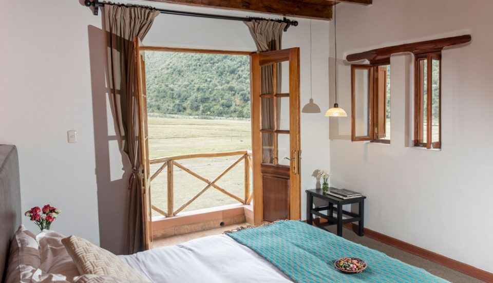 An elegant and inviting guest room at the Salkantay Lodge in Soraypampa