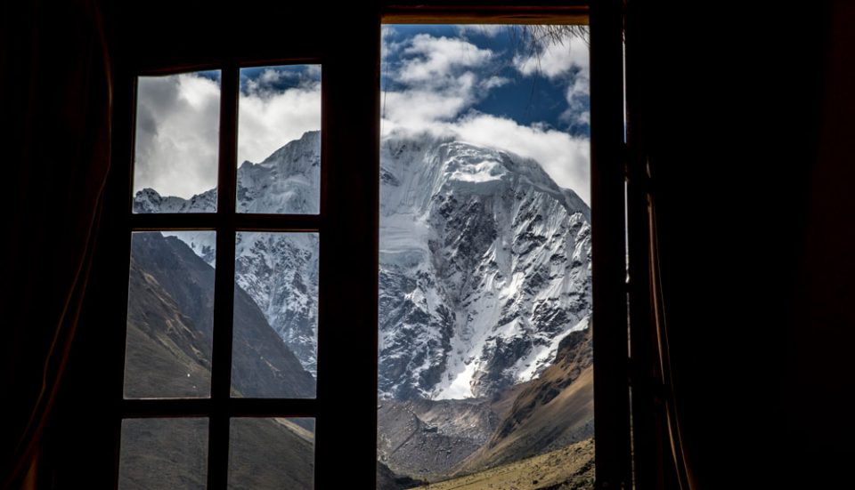 A view of the majestic Salkantay Peak from room your guest room
