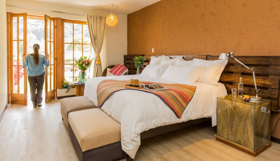 An inviting king guest room at the Lamay Lodge