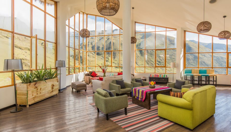 Dramatic views of Huacahuasi from the vibrant great room at the Huacahuasi Lodge